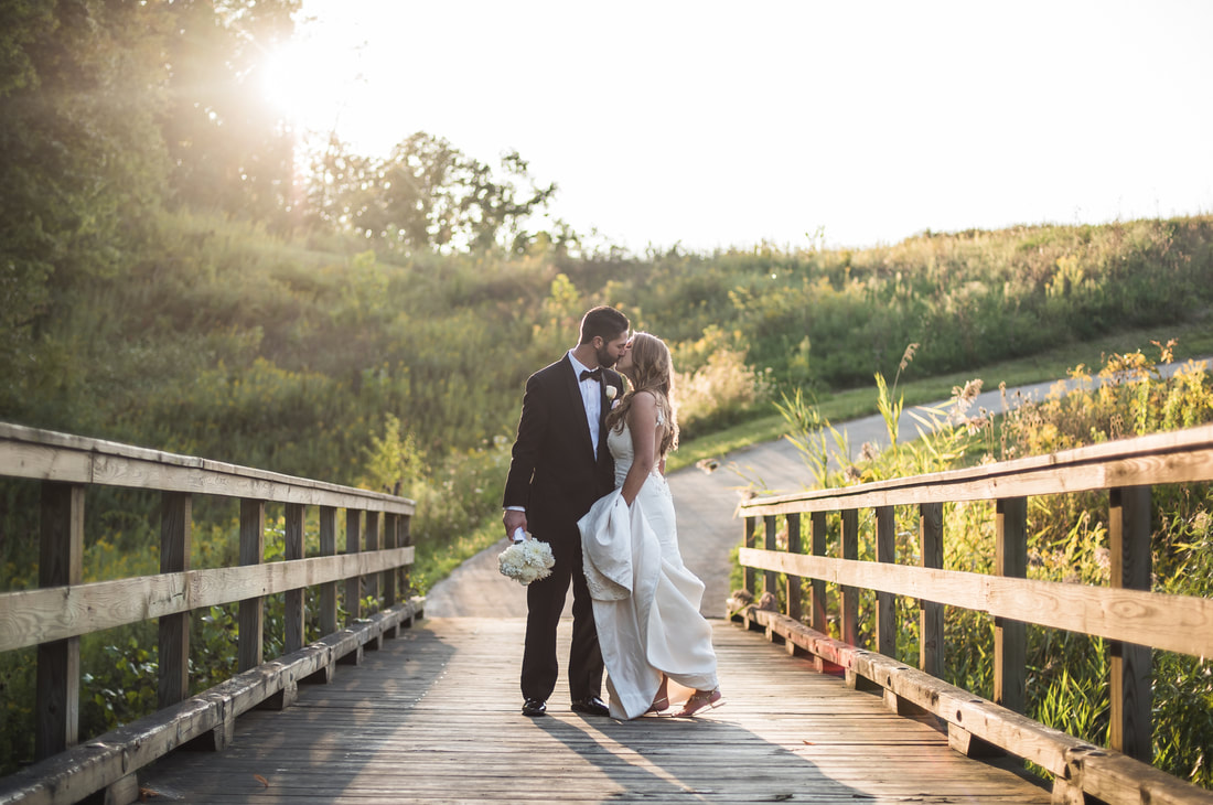 Akron Wedding Photo of a bride and groom at sunset.