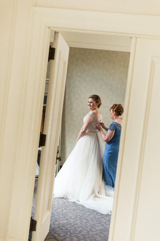 Akron Wedding Photographer- Bride smiles as she gets ready with mother Greystone Hall Wedding Akron Ohio