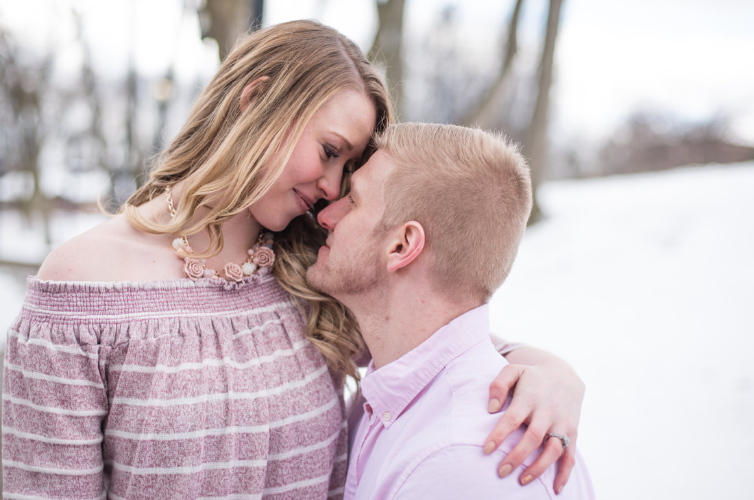 Engagement photo of couple on snowy day Coe Lake