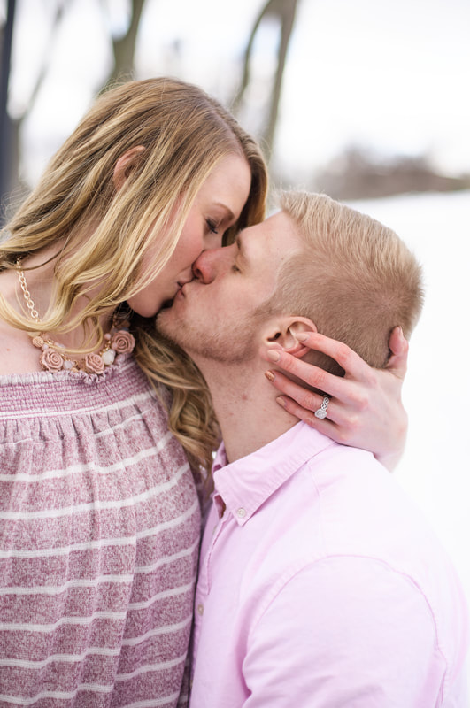 Couple Kissing at Coe Lake on snowy day