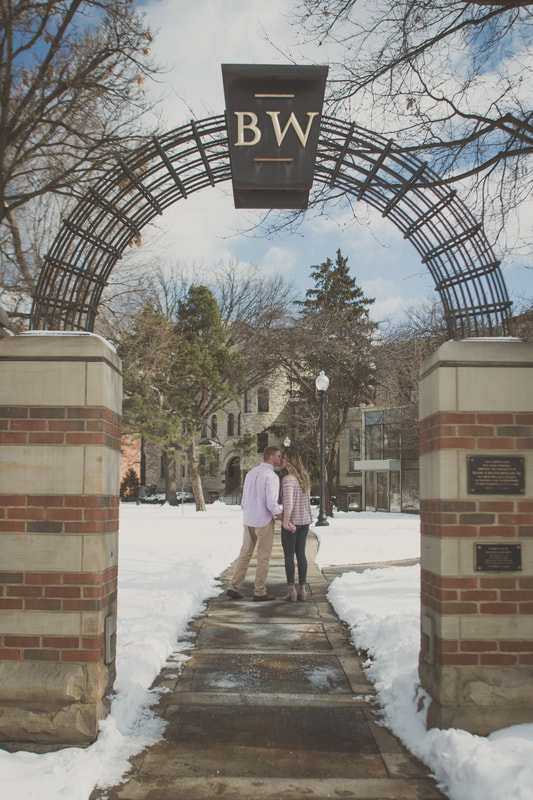 Photo of couple kissing under Baldwin Wallace arch