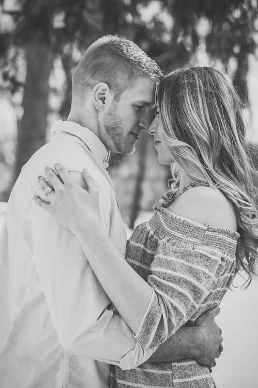 Photo of couple embracing in black and white Cleveland Ohio