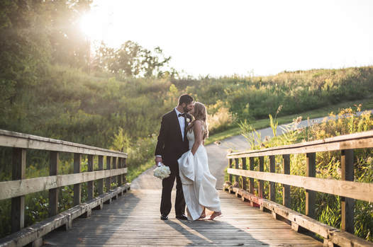 Akron Wedding Photo of a couple on the bridge at Blue Heron