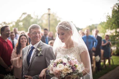 Akron Wedding Photo of a bride walking down the aisle with her dad.