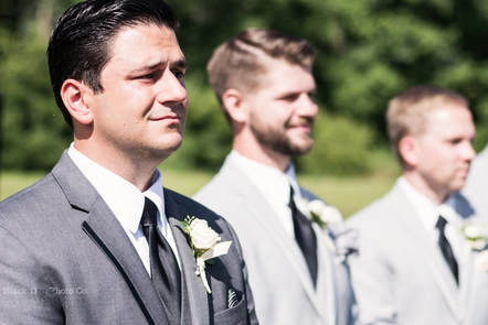 Akron Wedding Photo of a groom crying at a wedding ceremony.