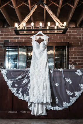 Akron Wedding Photo of a bride's dress hanging at Watersedge Vineyard.