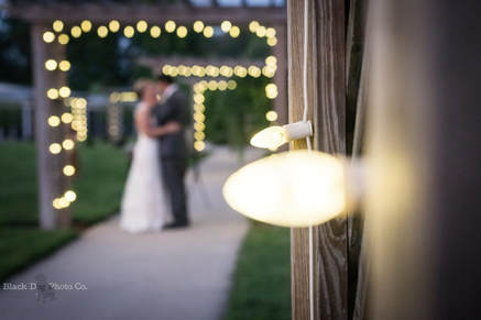 Akron Wedding Photo of a bride and groom in the lights at Watersedge Vineyard.
