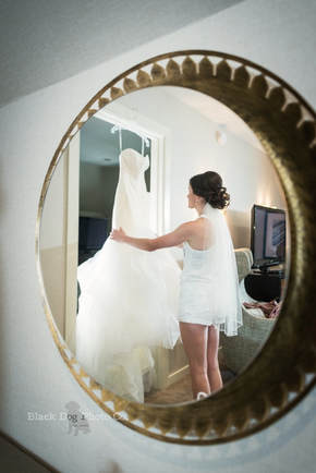 A Bride getting dressed at the Glidden House, Cleveland Wedding Photographer.