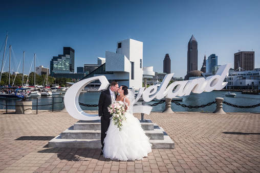 Cleveland Wedding Photo of a couple in front of the Rock and Roll Hall of Fame.