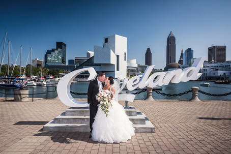 Cleveland Wedding Photo of a couple in front of the Cleveland skyline.