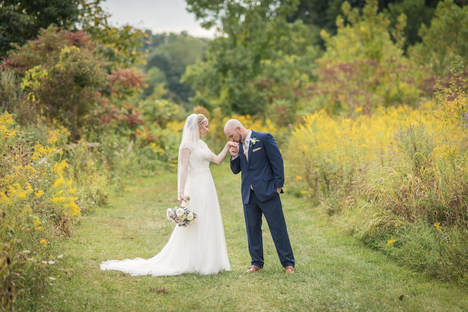 Akron Wedding Photo of a couple in wild flowers in the Cuyahoga Valley.