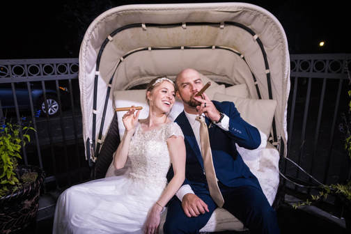 Akron Wedding Photo of a couple smoking cigars at Todaro's.
