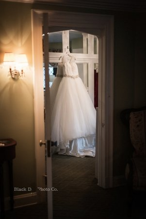 Photo of a wedding dress hanging at The Club at Hillbrook